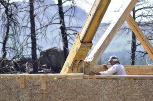 Timber framer Steve Rundquist adjusts a truss on Curt Busby's home off Buckhorn Road.